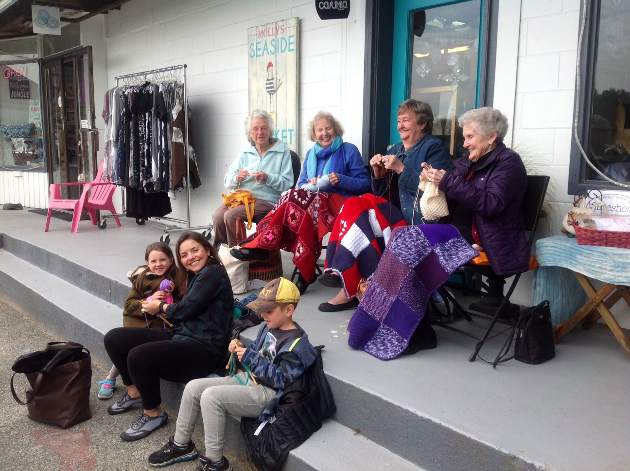 Knitter's on steps of Unwind